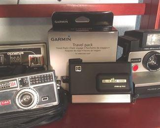 Assorted cameras: Olympus XA with flash; Canon IXUS Z-70; Samsung SL502 ; Polaroid Pronto!B; Kodak Disc 6100 with closeup lens; Kodak Instamatic 304