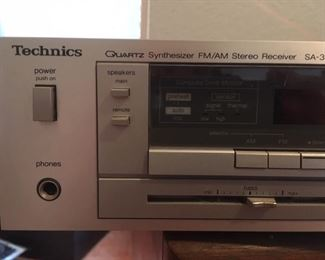 Quartz synthesizer FM/AM stereo receiver, Model SA-310 by Technics, with manual