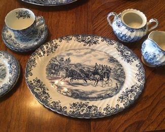 "Ironstone platter, plates, cup and saucer, creamer and sugar in blue transferware, ""Coaching Scene"" by Johnson Bros., England"
