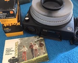 Kodak slide projector with accessories, folding screen and boxed carousels