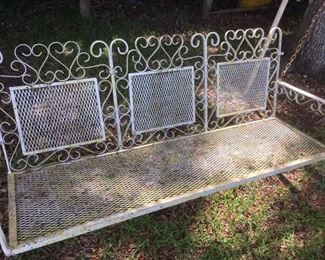 Wrought iron & mesh 3-person swing in pale yellow paint