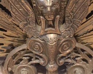 Detail of brass fireplace fan