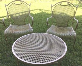 Pair of wrought iron & mesh arm chairs & coffee table in pale yellow paint