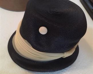 Black and white felt hat with buttons and band