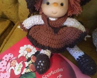 Strawberry Shortcake-style doll and Strawberry Shortcake coloring book