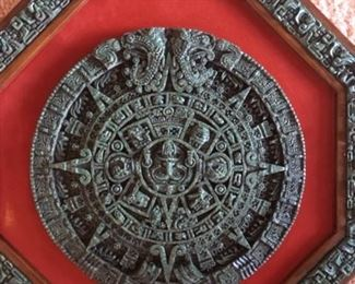 "Vintage octagonal ""Aztec Sun"" wall plaque in dimensional carved stone with red velvet inlay from Cuernavaca, Morelos by Creaciones Zarebski"