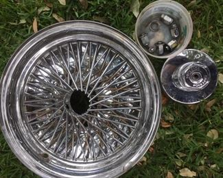 One of a set of four 15x7 chromed steel wire rims with hardware, by Superior