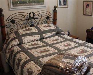 beautiful bed fram handmade duck quilt, lamp and original art