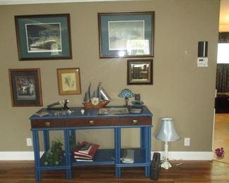 claery #'d prints,antique rattan table, ship clock original art