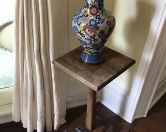 Antique cloisonné vase on one of a pair of stands.