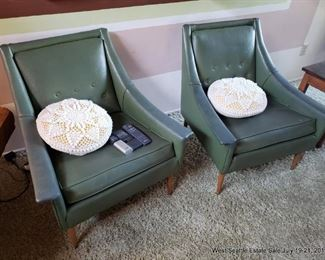 Naugahyde club chairs