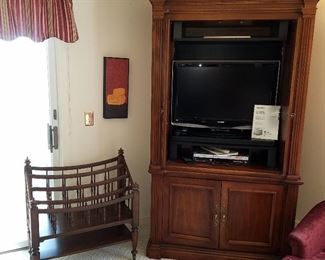 Entertainment center, newer TV, Canterbury rack for magazines, books, music, etc.
