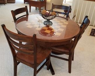 Checkerboard top table with 4 chairs (has glass over wood top)