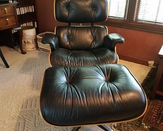 Eames lounge (670) and ottoman (671). Black leather