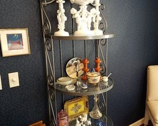 Iron & glass credenza displaying china and other items. Top set is Spode