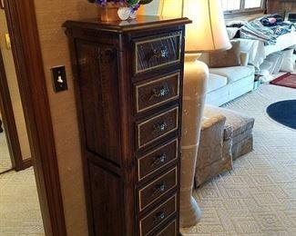 Lingerie chest, ceramic floor lamp behind it