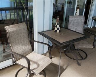 Pair of swivel chairs with tile top table