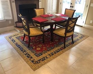 """Table measures 60"""" x 42 3/4"""" x 30"""" tall. Rug measures 7' x 9'."""