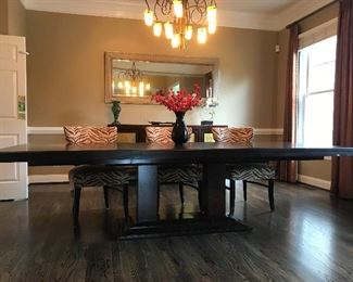 Large Contemporary Dining Table with 2 leaves and protective table pads.