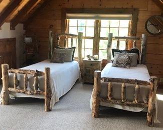 Rustic natural log twin beds