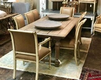 Set of eight Italian distressed painted chairs covered in leather. Paired with a rustic farm  trestle table. Pair of large Tunis bowls on the table top.