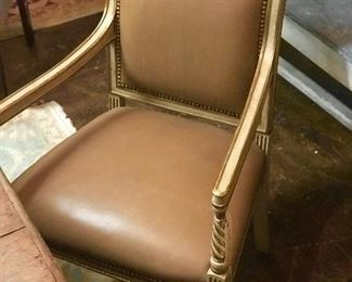 Distressed painted Italian leather chairs covered in leather.