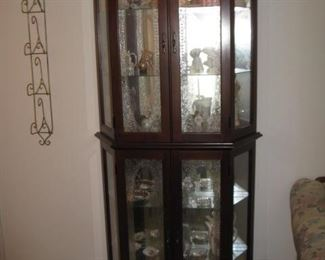 another lighted curio cabinet