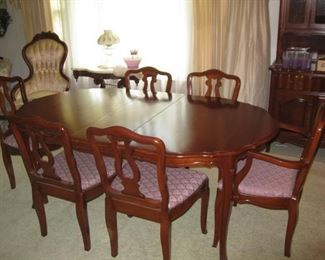 Cherry dining table with 3 leaves, pads, 8 chairs