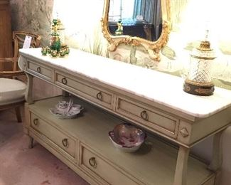 Marble top sideboard and crystal lamps.