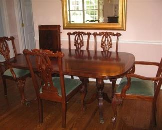 Double pedestal edge banded mahogany table with 2 armchairs, 3 side chairs and an extra armchair is a similar style
