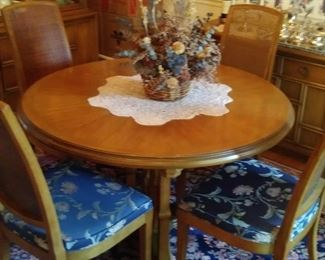 Pedestal table with four matching chairs