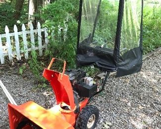 Snow blower with plastic walk  behind cab