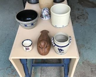 One drawer dropleaf table sporting ceramics