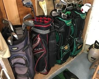 Golf bags, golf clubs, T box and putters caddie