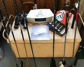 Assorted  Quality golf clubs,  golf balls, fishing poles,  binoculars and Bose wave radio