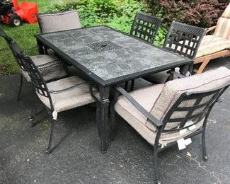 Slate top patio table with six matching chairs