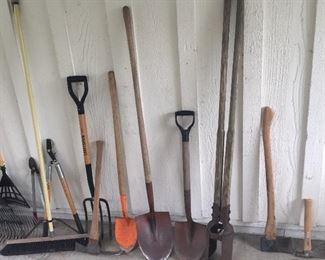 More yard tools: shovels, post hole digger, pitchfork, axes