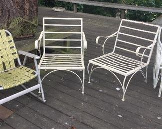 Vintage patio furniture (chairs) - webbed chair on the left is a rocker.