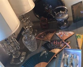 Pair of glass lamps with crystals, vintage fans, antique tin tray with mother of pearl inlay, silverplate teapot on stand