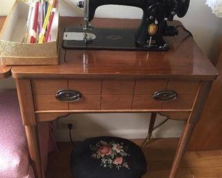 1955 Singer sewing machine, knitting needles, needlepoint stool