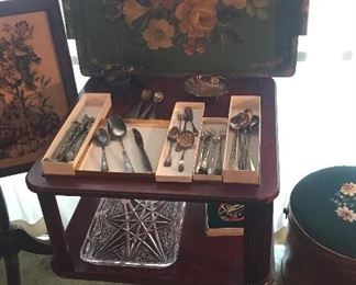 2 tier mahogany end table, green wood tole tray, misc. silverplate flatware