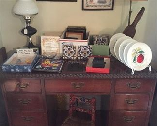 Vintage mahogany desk, painted child's chair, decorative tiles, samplers, milk glass plates with fruit designs