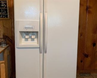 Refrigerator with ice and water in door