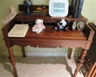 Antique desk with pull out writing surface