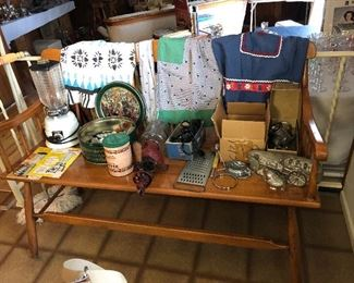 Hand fashioned wooden bench, Many old tin candy molds, vintage aprons