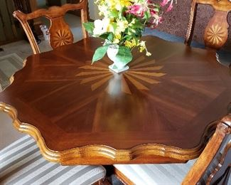 Stunning formal inlaid wood dining room set, table and chairs shown