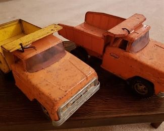 Two vintage Tonka dump trucks