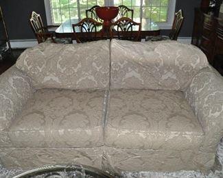 "Beige Quatrine slip cover sofa, 6'9"" w x 30""h x 40""d"