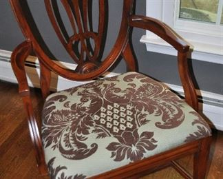 Newly upholstered mahogany shield back arm chair included with 5 armless chairs dining chairs