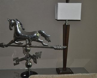 """Fantastic silver stainless weather-vane arrow and galloping horse on marble base shown, 33""""w x 26""""h with a contemporary wood and chrome table lamp (2 available)"""